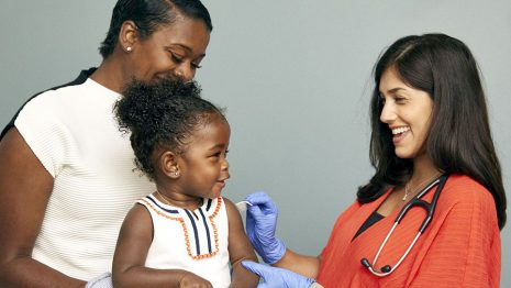 A child with her doctor